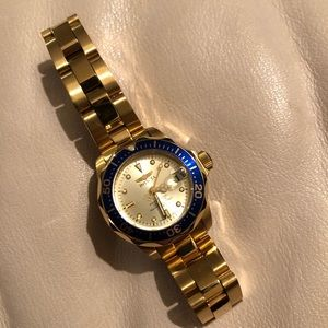Invicta Gold Link Watch with Blue Ringed Face